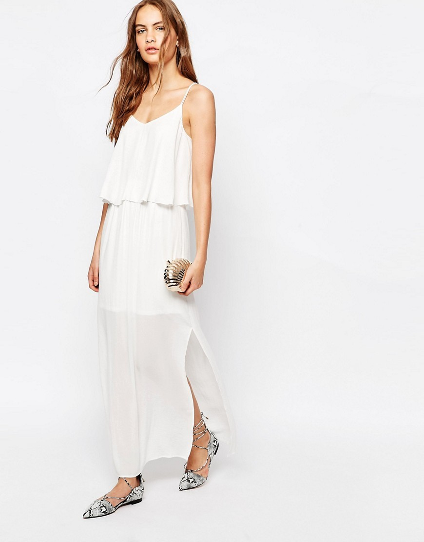 Strappy Back Maxi Dress Cloud Dancer - neckline: low v-neck; sleeve style: spaghetti straps; pattern: plain; style: maxi dress; length: ankle length; bust detail: ruching/gathering/draping/layers/pintuck pleats at bust; predominant colour: white; occasions: casual; fit: body skimming; fibres: polyester/polyamide - 100%; hip detail: slits at hip; sleeve length: sleeveless; texture group: sheer fabrics/chiffon/organza etc.; pattern type: fabric; season: s/s 2016