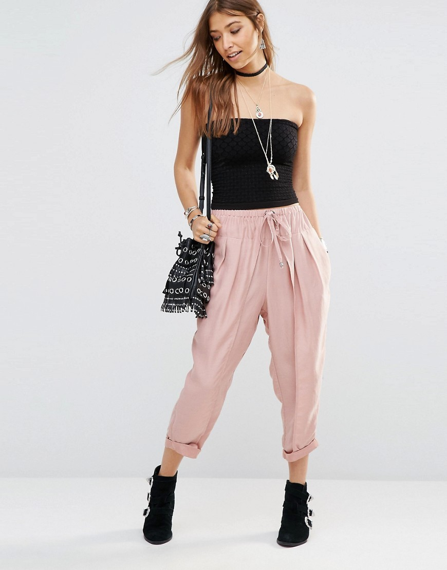 Slouchy Harem Trousers Vintage Blush - pattern: plain; style: harem/slouch; waist: high rise; waist detail: belted waist/tie at waist/drawstring; predominant colour: blush; occasions: casual; length: ankle length; fibres: polyester/polyamide - 100%; jeans & bottoms detail: turn ups; texture group: crepes; fit: baggy; pattern type: fabric; season: s/s 2016; wardrobe: highlight