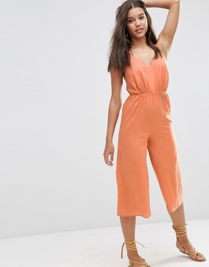 V Plunge Coulotte Beach Jumpsuit Rust - neckline: low v-neck; sleeve style: spaghetti straps; fit: fitted at waist; pattern: plain; waist detail: elasticated waist; predominant colour: terracotta; occasions: casual, holiday; length: calf length; fibres: cotton - 100%; sleeve length: sleeveless; texture group: cotton feel fabrics; style: jumpsuit; pattern type: fabric; season: s/s 2016