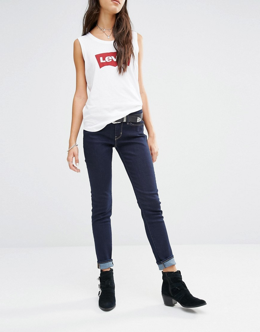 Levis 711 Mid Rise Skinny Jeans Lone Wolf Blue - style: skinny leg; length: standard; pattern: plain; pocket detail: traditional 5 pocket; waist: mid/regular rise; predominant colour: navy; occasions: casual; fibres: cotton - stretch; texture group: denim; pattern type: fabric; season: s/s 2016