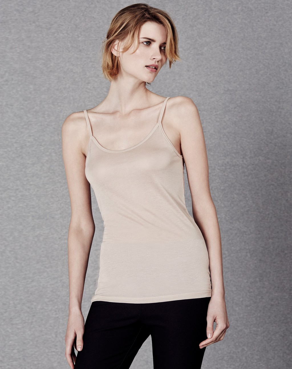 Invisible Cami Nude - sleeve style: spaghetti straps; pattern: plain; style: camisole; predominant colour: nude; occasions: casual; length: standard; neckline: scoop; fibres: viscose/rayon - 100%; fit: body skimming; sleeve length: sleeveless; texture group: jersey - clingy; pattern type: fabric; season: a/w 2015; wardrobe: basic