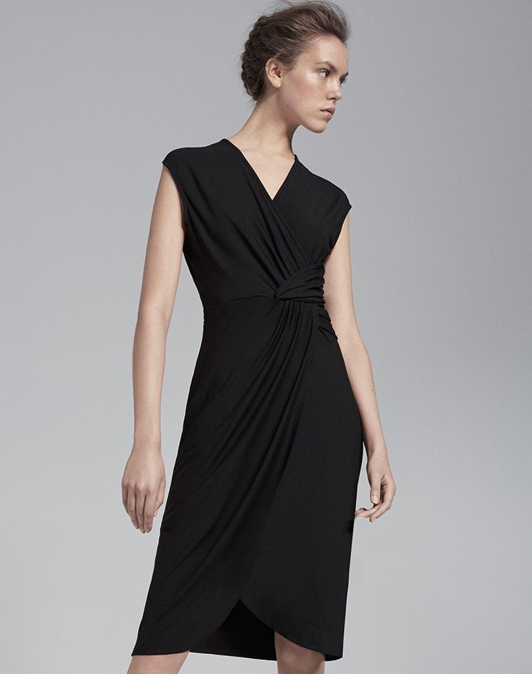 Twist Knot Wrap Dress Black - style: faux wrap/wrap; neckline: v-neck; sleeve style: capped; pattern: plain; bust detail: subtle bust detail; predominant colour: black; occasions: work; length: on the knee; fit: body skimming; fibres: cotton - stretch; hip detail: adds bulk at the hips; sleeve length: sleeveless; pattern type: fabric; texture group: jersey - stretchy/drapey; season: s/s 2016; wardrobe: investment