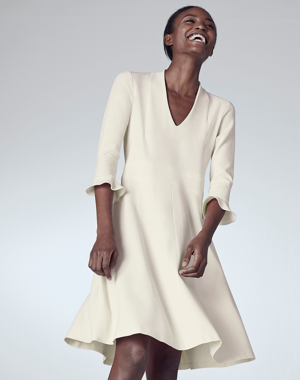V Neck Flippy Dress Cream - style: trapeze; neckline: v-neck; fit: loose; pattern: plain; sleeve style: trumpet; predominant colour: ivory/cream; occasions: evening; length: just above the knee; fibres: wool - 100%; sleeve length: 3/4 length; texture group: crepes; pattern type: fabric; season: s/s 2016; wardrobe: event