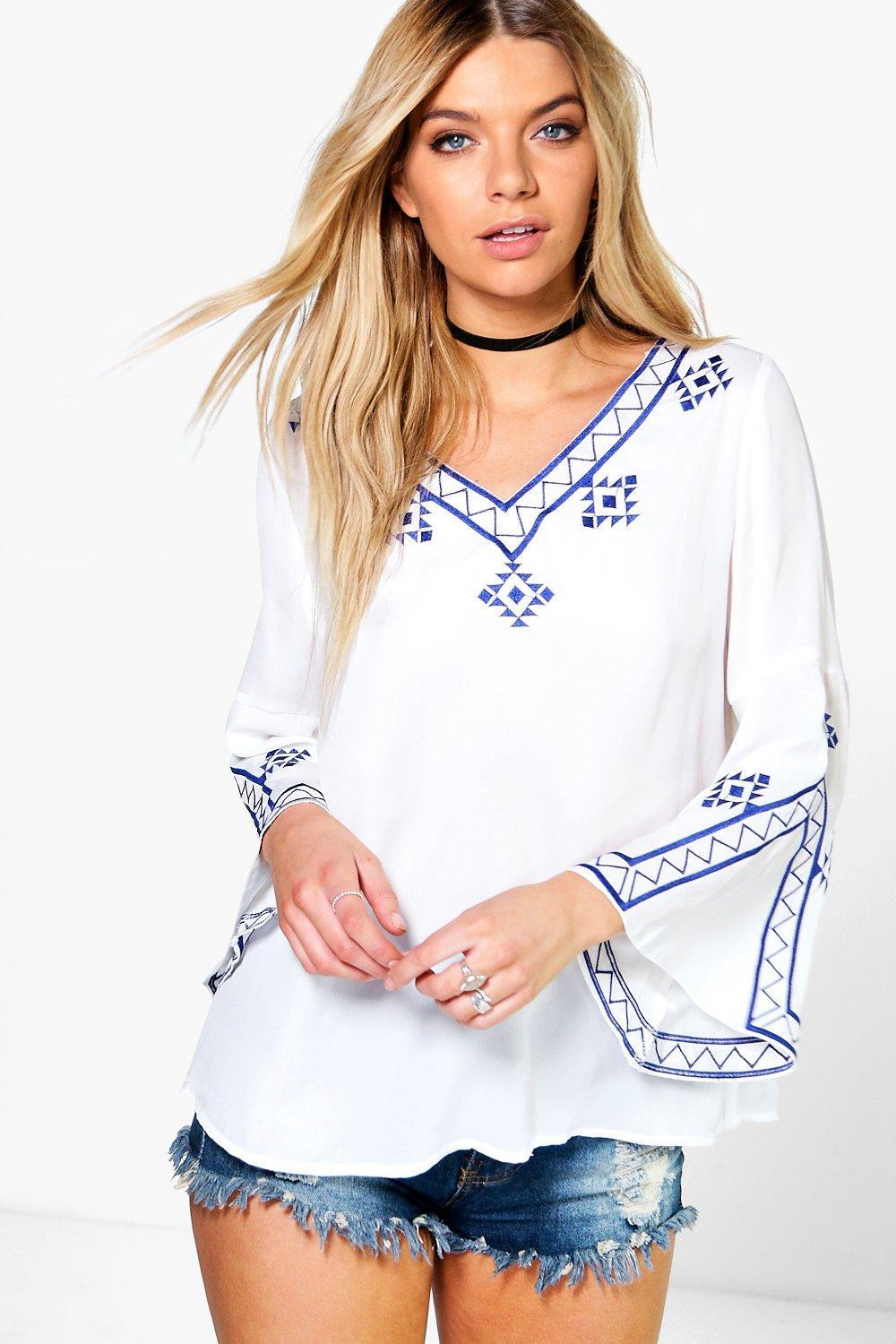 Embroidered Flute Sleeve Blouse White - neckline: v-neck; style: blouse; predominant colour: white; secondary colour: royal blue; occasions: casual; length: standard; fibres: polyester/polyamide - 100%; fit: loose; sleeve length: long sleeve; sleeve style: standard; texture group: cotton feel fabrics; pattern type: fabric; pattern: patterned/print; embellishment: embroidered; multicoloured: multicoloured; season: s/s 2016; wardrobe: highlight