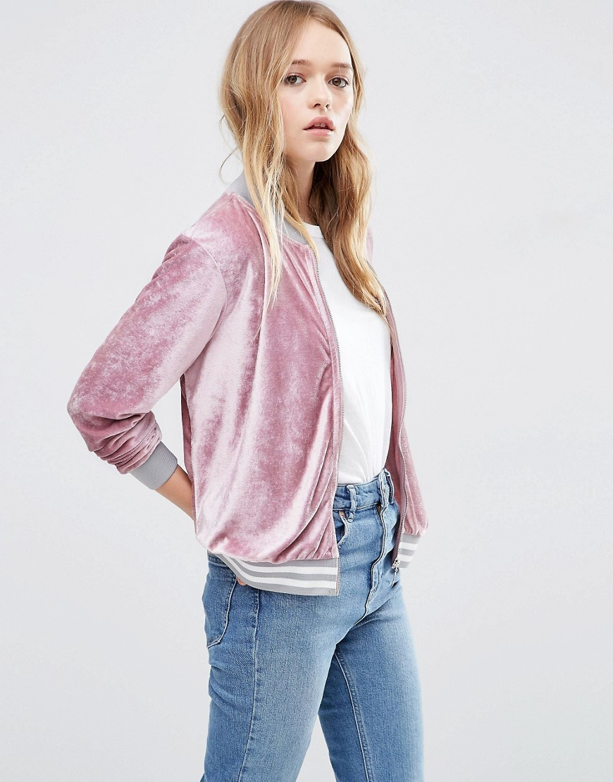 Bomber Jacket In Velvet Pink - pattern: plain; collar: round collar/collarless; style: bomber; secondary colour: white; occasions: casual; length: standard; fit: straight cut (boxy); fibres: polyester/polyamide - stretch; sleeve length: long sleeve; sleeve style: standard; collar break: high; pattern type: fabric; texture group: velvet/fabrics with pile; predominant colour: dusky pink; season: s/s 2016; wardrobe: highlight