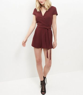 Burgundy Wrap Front Tie Waist Playsuit - neckline: v-neck; pattern: plain; waist detail: belted waist/tie at waist/drawstring; length: short shorts; predominant colour: burgundy; occasions: casual; fit: body skimming; fibres: polyester/polyamide - stretch; sleeve length: short sleeve; sleeve style: standard; texture group: corduroy; style: playsuit; pattern type: fabric; season: s/s 2016; wardrobe: highlight