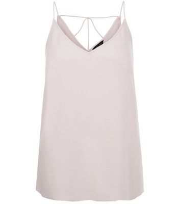 Mid Pink Strappy Back Cami - neckline: v-neck; sleeve style: spaghetti straps; pattern: plain; style: camisole; predominant colour: blush; occasions: casual; length: standard; fibres: viscose/rayon - 100%; fit: body skimming; sleeve length: sleeveless; texture group: crepes; pattern type: fabric; season: s/s 2016; wardrobe: basic