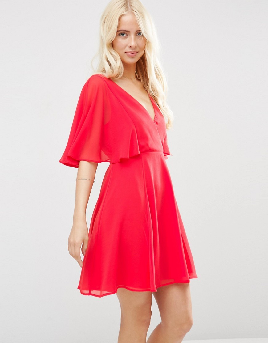 Wrap Front Mini Dress With Angel Sleeve Red - style: tea dress; neckline: low v-neck; fit: fitted at waist; pattern: plain; predominant colour: true red; occasions: evening; length: just above the knee; fibres: polyester/polyamide - 100%; sleeve length: half sleeve; sleeve style: standard; pattern type: fabric; texture group: other - light to midweight; season: s/s 2016; wardrobe: event