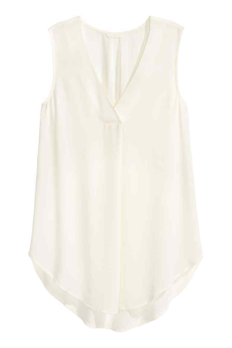Crêpe Blouse - neckline: v-neck; pattern: plain; sleeve style: sleeveless; length: below the bottom; predominant colour: ivory/cream; occasions: evening; style: top; fibres: polyester/polyamide - 100%; fit: body skimming; sleeve length: sleeveless; texture group: crepes; pattern type: fabric; season: s/s 2016