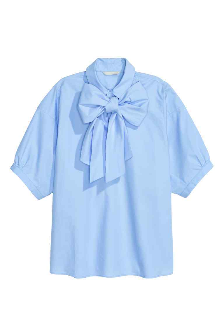 Pussy Bow Blouse - pattern: plain; neckline: pussy bow; style: blouse; predominant colour: pale blue; occasions: casual; length: standard; fibres: cotton - 100%; fit: body skimming; sleeve length: short sleeve; sleeve style: standard; texture group: cotton feel fabrics; pattern type: fabric; season: s/s 2016; wardrobe: highlight