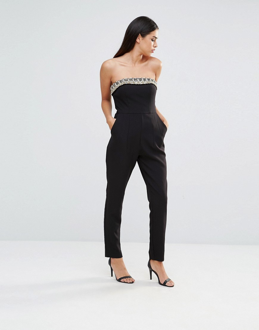 Bethany Bandeau Jumpsuit Black - length: standard; neckline: strapless (straight/sweetheart); pattern: plain; sleeve style: strapless; predominant colour: black; occasions: evening; fit: body skimming; fibres: polyester/polyamide - stretch; sleeve length: sleeveless; style: jumpsuit; pattern type: fabric; texture group: jersey - stretchy/drapey; season: s/s 2016; wardrobe: event