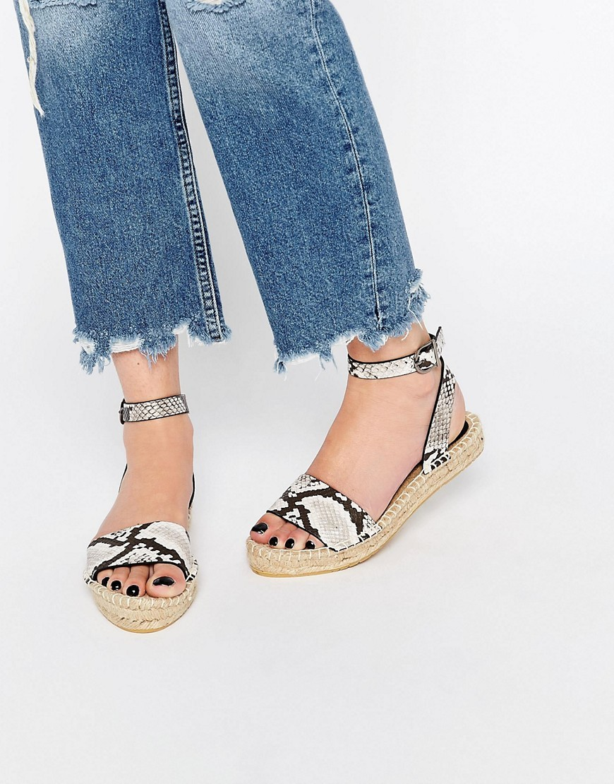 Joni Espadrille Sandals Snake - predominant colour: black; occasions: casual, holiday; material: fabric; heel height: flat; ankle detail: ankle strap; heel: standard; toe: open toe/peeptoe; style: strappy; finish: plain; pattern: animal print; season: s/s 2016; wardrobe: highlight