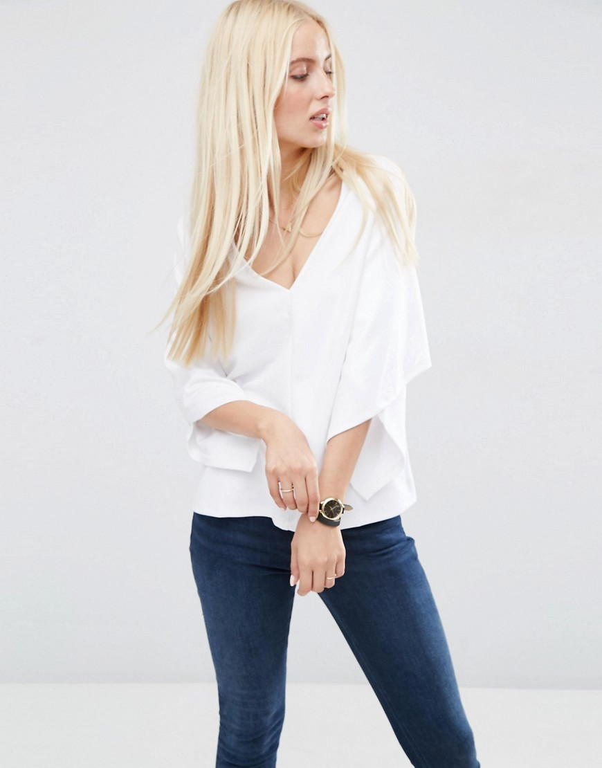 Shell Top With Wrap Sleeve White - neckline: low v-neck; sleeve style: dolman/batwing; pattern: plain; style: blouse; predominant colour: ivory/cream; occasions: casual, creative work; length: standard; fibres: polyester/polyamide - 100%; fit: straight cut; sleeve length: 3/4 length; texture group: crepes; pattern type: fabric; season: s/s 2016; wardrobe: basic