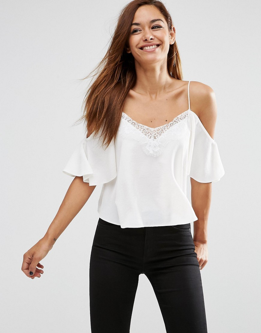 Cold Shoulder Cami Top With Lace Trim In Satin Finish White - neckline: low v-neck; pattern: plain; predominant colour: white; occasions: casual, evening, holiday; length: standard; style: top; fibres: polyester/polyamide - 100%; fit: body skimming; shoulder detail: cut out shoulder; sleeve length: half sleeve; sleeve style: standard; pattern type: fabric; texture group: other - light to midweight; embellishment: lace; season: s/s 2016; wardrobe: highlight
