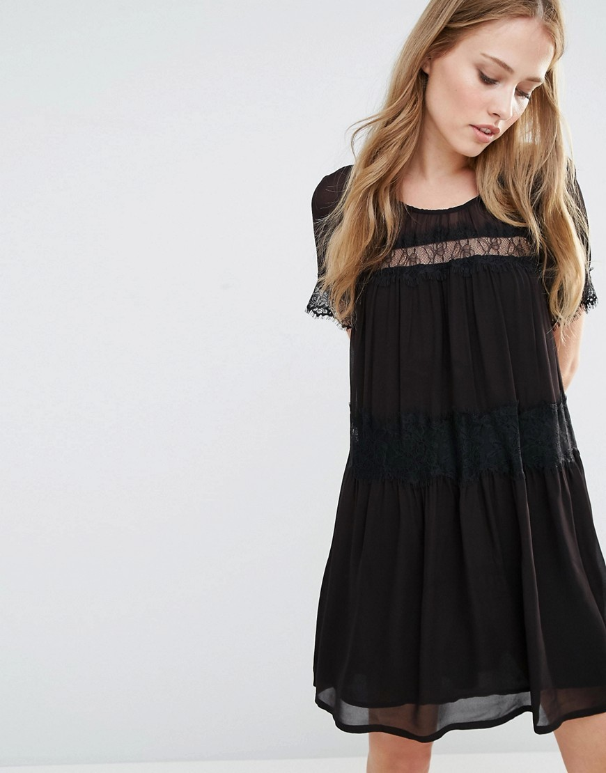 Rosie Lace Smock Dress Black - style: smock; fit: loose; pattern: plain; bust detail: sheer at bust; predominant colour: black; occasions: evening; length: just above the knee; fibres: viscose/rayon - 100%; neckline: crew; sleeve length: short sleeve; sleeve style: standard; texture group: sheer fabrics/chiffon/organza etc.; pattern type: fabric; embellishment: lace; season: s/s 2016; wardrobe: event