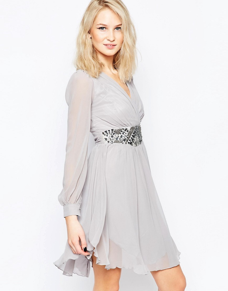 Long Sleeve Skater Dress With Embellished Waist Grey - style: faux wrap/wrap; neckline: v-neck; pattern: plain; waist detail: belted waist/tie at waist/drawstring; predominant colour: light grey; occasions: evening; length: just above the knee; fit: body skimming; fibres: polyester/polyamide - stretch; sleeve length: long sleeve; sleeve style: standard; texture group: sheer fabrics/chiffon/organza etc.; pattern type: fabric; embellishment: sequins; season: s/s 2016; wardrobe: event