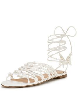 Bliss Knotted Tie Up The Leg Flat Sandal - predominant colour: white; occasions: casual, holiday; material: faux leather; heel height: flat; ankle detail: ankle tie; heel: standard; toe: open toe/peeptoe; style: strappy; finish: plain; pattern: plain; season: s/s 2016; wardrobe: basic