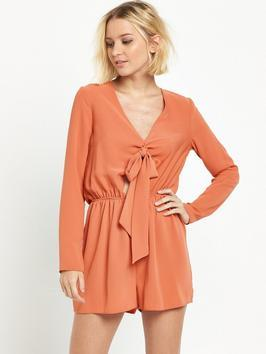Tie Front Playsuit - neckline: low v-neck; fit: fitted at waist; pattern: plain; length: short shorts; predominant colour: terracotta; occasions: casual; fibres: polyester/polyamide - 100%; sleeve length: long sleeve; sleeve style: standard; texture group: crepes; style: playsuit; pattern type: fabric; season: s/s 2016; wardrobe: highlight