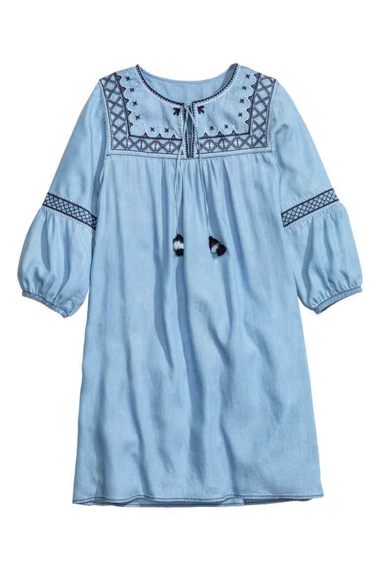 Lyocell Tunic - style: tunic; sleeve style: balloon; predominant colour: pale blue; secondary colour: navy; occasions: casual, holiday; neckline: peep hole neckline; fibres: cotton - 100%; fit: loose; length: mid thigh; sleeve length: 3/4 length; texture group: cotton feel fabrics; pattern type: fabric; pattern size: light/subtle; pattern: patterned/print; embellishment: embroidered; season: s/s 2016; wardrobe: highlight