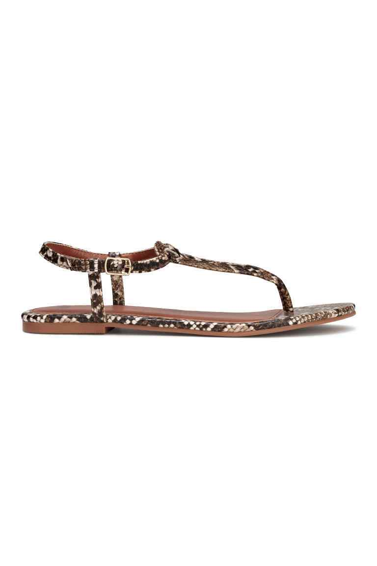 Toe Post Sandals - predominant colour: chocolate brown; secondary colour: stone; occasions: casual, holiday; material: faux leather; heel height: flat; ankle detail: ankle strap; heel: standard; toe: open toe/peeptoe; style: strappy; finish: plain; pattern: animal print; season: s/s 2016; wardrobe: highlight