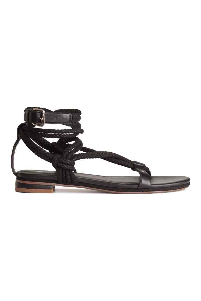 Sandals - predominant colour: black; occasions: casual, holiday; material: faux leather; heel height: flat; ankle detail: ankle tie; heel: standard; toe: toe thongs; style: strappy; finish: plain; pattern: plain; season: s/s 2016; wardrobe: basic
