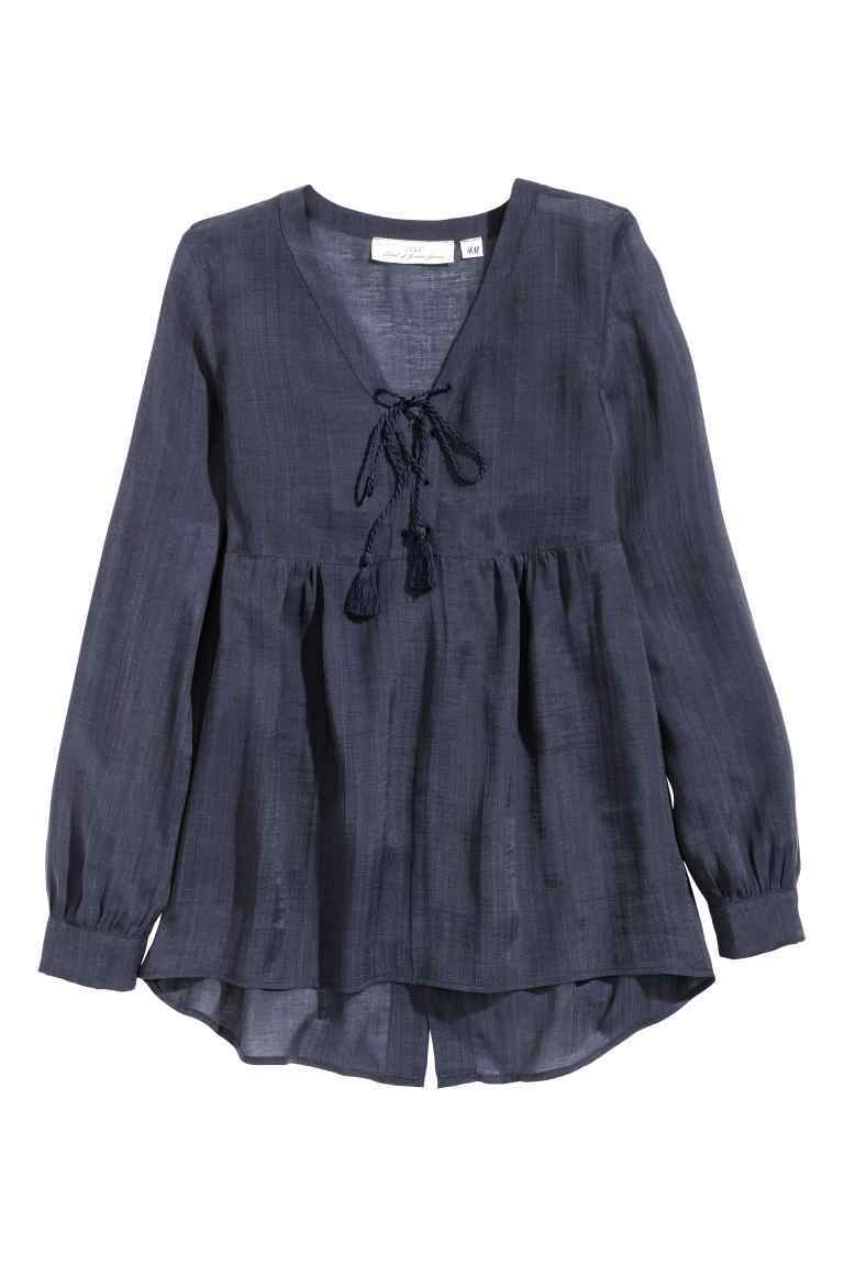 Blouse In A Lyocell Blend - neckline: low v-neck; pattern: plain; style: blouse; predominant colour: navy; occasions: casual, creative work; length: standard; fibres: linen - 100%; fit: loose; hip detail: subtle/flattering hip detail; back detail: longer hem at back than at front; sleeve length: long sleeve; sleeve style: standard; pattern type: fabric; texture group: other - light to midweight; season: s/s 2016; wardrobe: basic