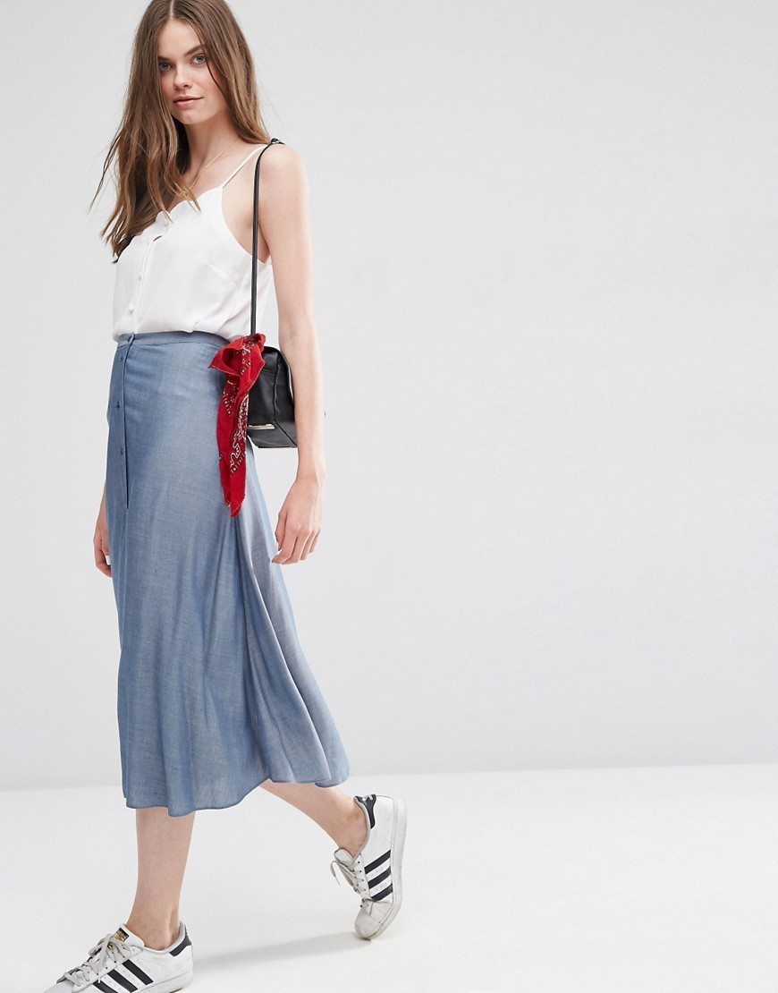 Button Through Midi Skirt In Chambray Blue - length: below the knee; pattern: plain; fit: loose/voluminous; style: pleated; waist: high rise; predominant colour: pale blue; occasions: casual, creative work; fibres: viscose/rayon - 100%; pattern type: fabric; texture group: other - light to midweight; season: s/s 2016; wardrobe: highlight