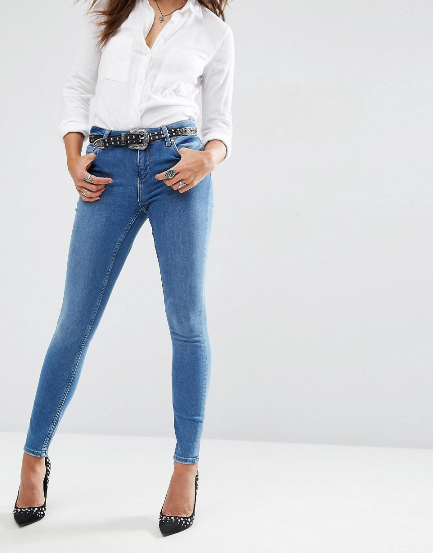 Lisbon Mid Rise Skinny Jeans In Jessie Dark Stonewash Mid Wash Blue - style: skinny leg; length: standard; pattern: plain; waist: high rise; pocket detail: traditional 5 pocket; predominant colour: denim; occasions: casual; fibres: cotton - stretch; texture group: denim; pattern type: fabric; season: s/s 2016; wardrobe: basic