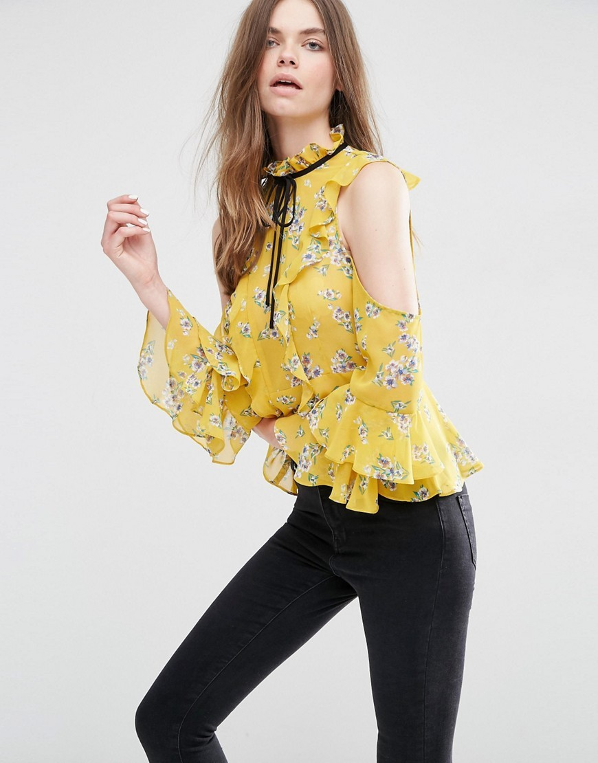 Cold Shoulder Ruffle Blouse In Floral Print Multi - sleeve style: bell sleeve; neckline: pussy bow; style: blouse; predominant colour: yellow; secondary colour: black; occasions: evening, creative work; length: standard; fibres: polyester/polyamide - 100%; fit: body skimming; shoulder detail: cut out shoulder; sleeve length: long sleeve; texture group: sheer fabrics/chiffon/organza etc.; pattern type: fabric; pattern: florals; pattern size: big & busy (top); season: s/s 2016; wardrobe: highlight