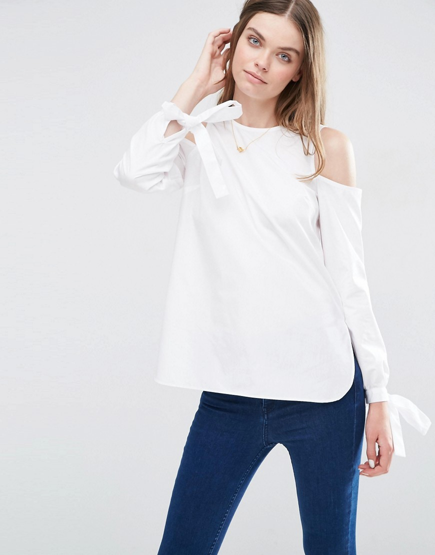 Cold Shoulder Top In Cotton With Tie Cuff Detail White - pattern: plain; predominant colour: white; occasions: casual; length: standard; style: top; fibres: cotton - 100%; fit: body skimming; neckline: crew; shoulder detail: cut out shoulder; sleeve length: long sleeve; sleeve style: standard; pattern type: fabric; texture group: woven light midweight; season: s/s 2016; wardrobe: highlight
