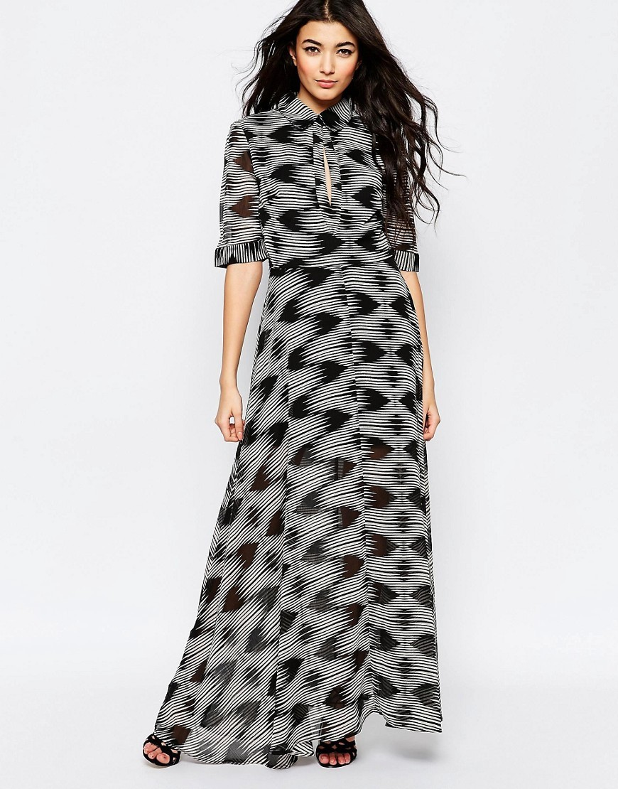 Maxi Shirt Dress In Geo Wave Print Black/White - neckline: shirt collar/peter pan/zip with opening; style: maxi dress; hip detail: draws attention to hips; predominant colour: mid grey; secondary colour: black; occasions: casual; length: floor length; fit: body skimming; fibres: polyester/polyamide - 100%; sleeve length: 3/4 length; sleeve style: standard; pattern type: fabric; pattern: patterned/print; texture group: other - light to midweight; multicoloured: multicoloured; season: s/s 2016; wardrobe: highlight