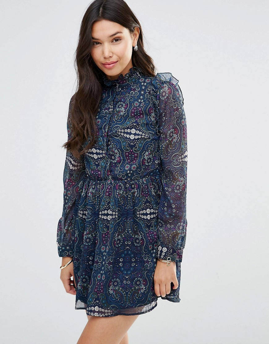 Ruffle Long Sleeve Dress In Paisley Paisley Print - style: shift; length: mid thigh; fit: fitted at waist; neckline: high neck; pattern: paisley; secondary colour: white; predominant colour: navy; occasions: evening; fibres: polyester/polyamide - 100%; sleeve length: long sleeve; sleeve style: standard; texture group: sheer fabrics/chiffon/organza etc.; pattern type: fabric; multicoloured: multicoloured; season: s/s 2016; wardrobe: event