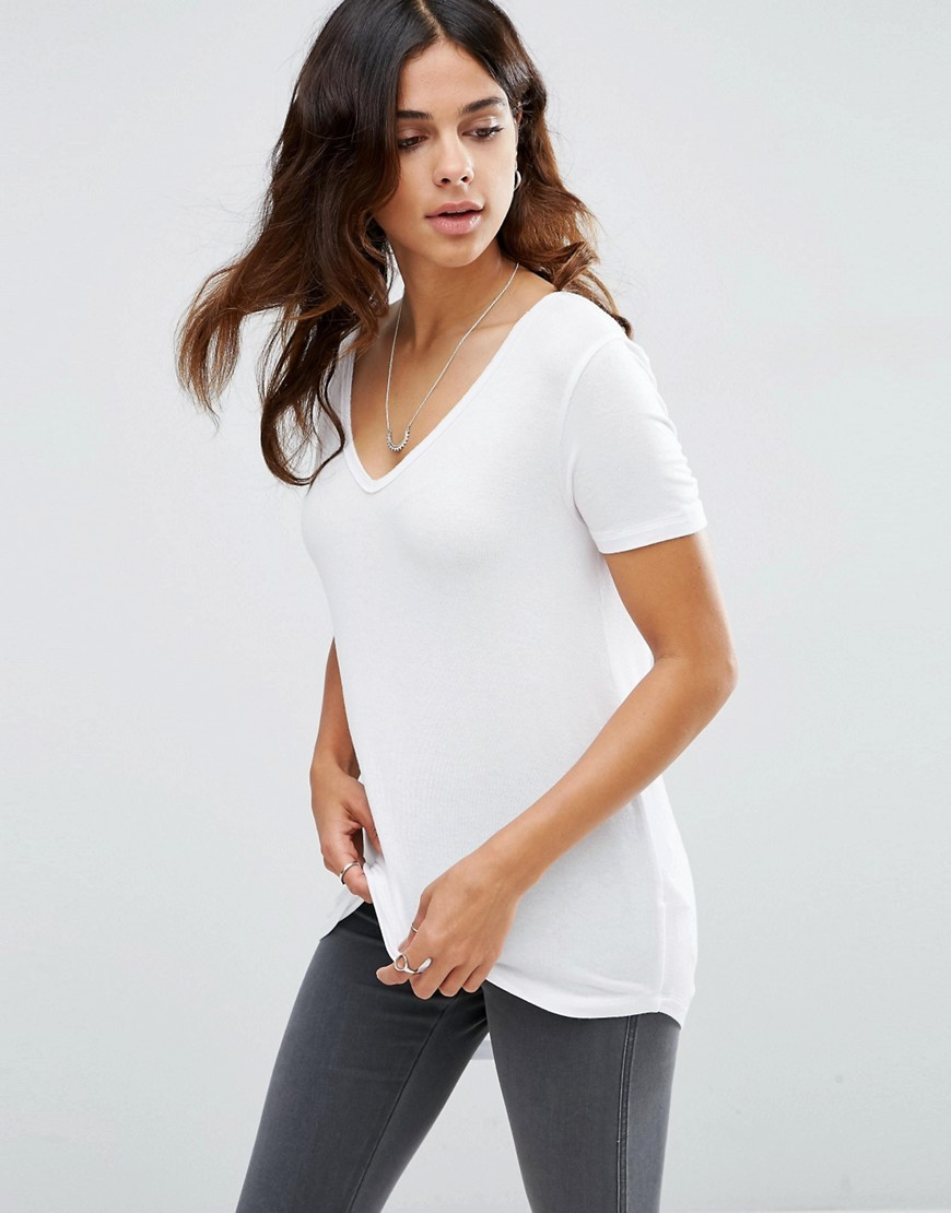The New Forever T Shirt With Short Sleeves And Dip Back White - neckline: v-neck; pattern: plain; length: below the bottom; style: t-shirt; predominant colour: white; occasions: casual, creative work; fibres: viscose/rayon - stretch; fit: body skimming; sleeve length: short sleeve; sleeve style: standard; pattern type: fabric; texture group: jersey - stretchy/drapey; season: s/s 2016; wardrobe: basic