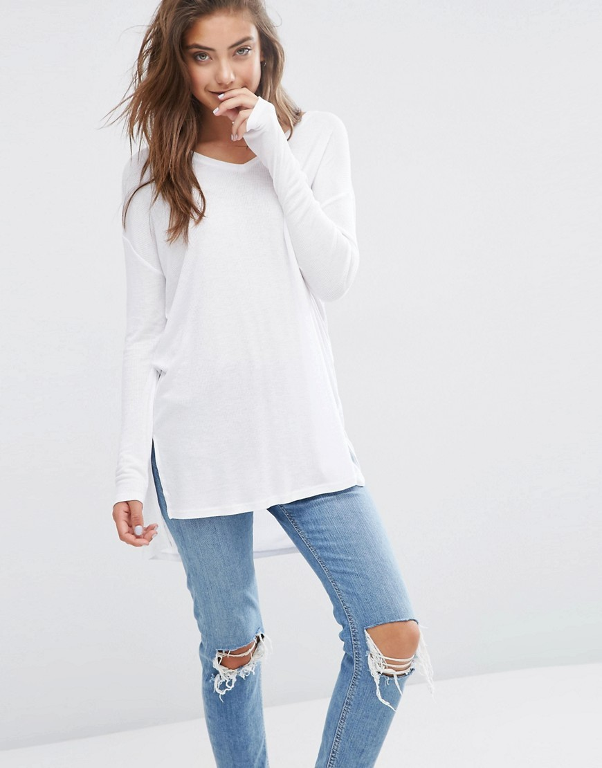 Top With V Neck In Slouchy Rib White - neckline: v-neck; pattern: plain; length: below the bottom; predominant colour: white; occasions: casual, creative work; style: top; fit: loose; sleeve length: long sleeve; sleeve style: standard; pattern type: fabric; texture group: jersey - stretchy/drapey; fibres: viscose/rayon - mix; season: s/s 2016; wardrobe: basic