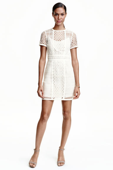 Short Lace Dress - length: mid thigh; bust detail: sheer at bust; predominant colour: white; occasions: evening; fit: fitted at waist & bust; style: fit & flare; fibres: polyester/polyamide - 100%; neckline: crew; sleeve length: short sleeve; sleeve style: standard; texture group: lace; pattern type: fabric; pattern: patterned/print; season: s/s 2016