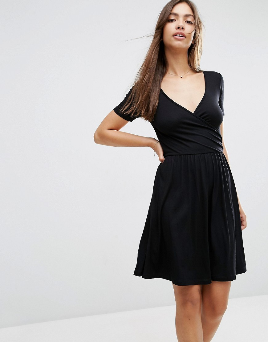 Wrap Skater Dress With Short Sleeves Black - style: faux wrap/wrap; neckline: v-neck; pattern: plain; predominant colour: black; occasions: evening; length: just above the knee; fit: body skimming; fibres: viscose/rayon - stretch; sleeve length: short sleeve; sleeve style: standard; pattern type: fabric; texture group: jersey - stretchy/drapey; season: s/s 2016; wardrobe: event
