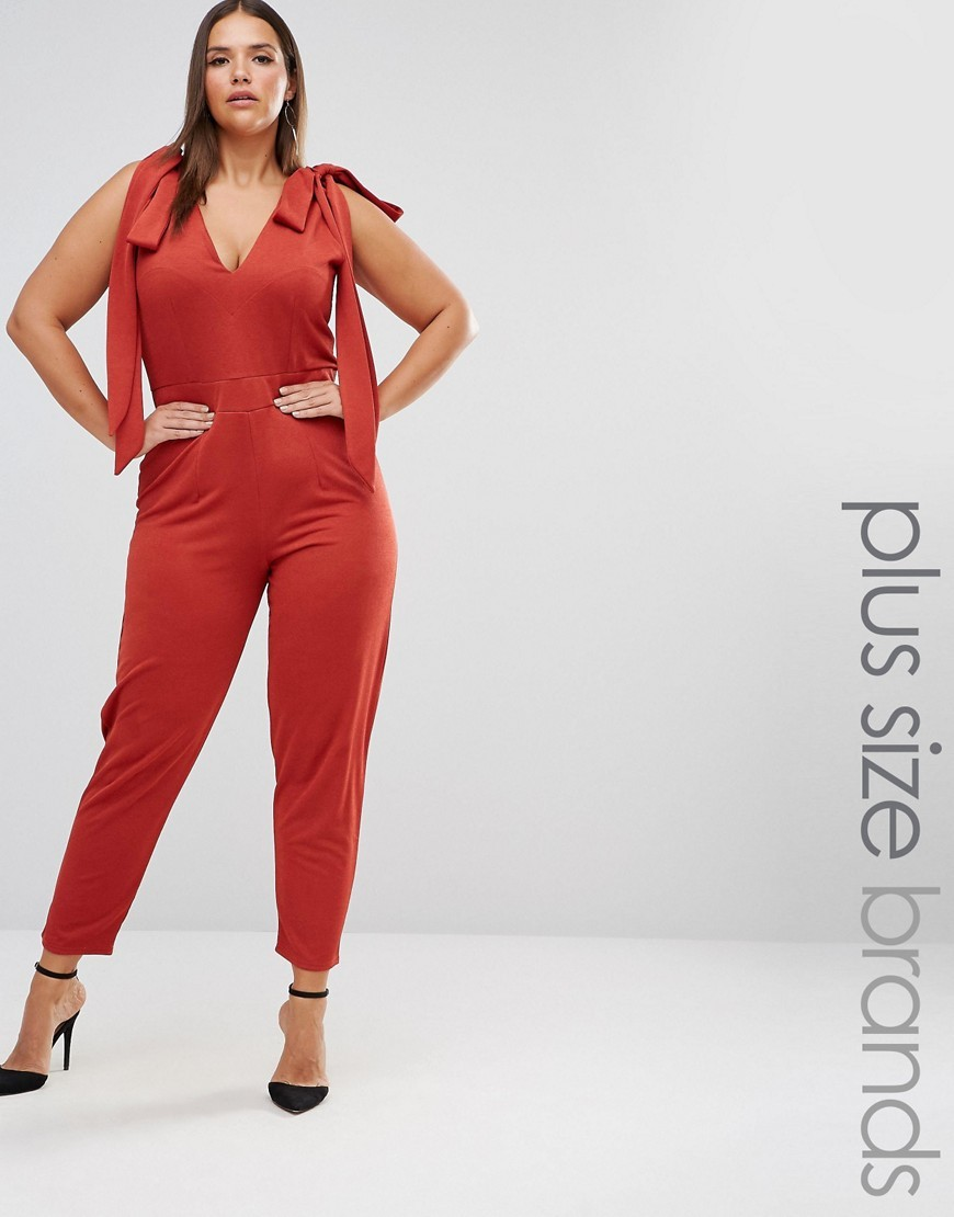 Sleeveless Plunge Jumpsuit With Bow Detail Red - length: standard; neckline: v-neck; pattern: plain; sleeve style: sleeveless; predominant colour: true red; occasions: casual, evening; fit: body skimming; fibres: polyester/polyamide - stretch; shoulder detail: bulky shoulder detail; sleeve length: sleeveless; style: jumpsuit; pattern type: fabric; texture group: jersey - stretchy/drapey; season: s/s 2016; wardrobe: highlight