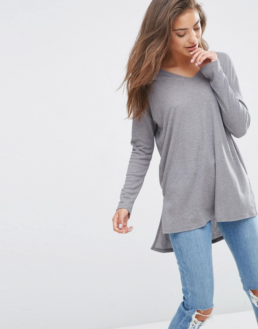 Top With V Neck In Slouchy Rib Grey - neckline: low v-neck; pattern: plain; predominant colour: light grey; occasions: casual, creative work; length: standard; style: top; fibres: polyester/polyamide - mix; fit: loose; sleeve length: long sleeve; sleeve style: standard; pattern type: fabric; texture group: jersey - stretchy/drapey; season: s/s 2016; wardrobe: basic