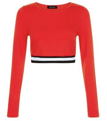 Red Elasticated Hem Long Sleeve Crop Top - length: cropped; predominant colour: true red; secondary colour: black; occasions: casual; style: top; fibres: cotton - stretch; fit: tight; neckline: crew; sleeve length: long sleeve; sleeve style: standard; pattern type: fabric; pattern size: standard; pattern: colourblock; texture group: jersey - stretchy/drapey; season: s/s 2016; wardrobe: highlight