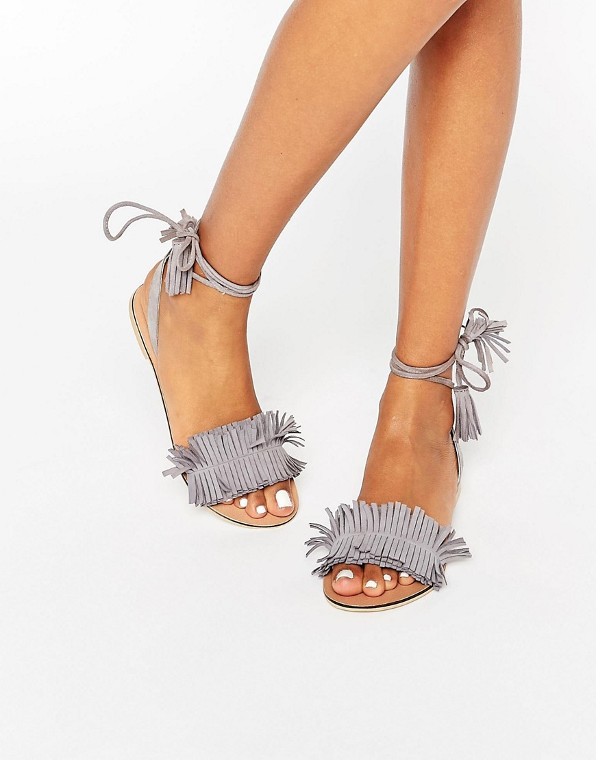Flashy Suede Tie Leg Fringe Sandals Grey - predominant colour: mid grey; occasions: casual, evening, holiday; material: suede; heel height: mid; ankle detail: ankle tie; heel: standard; toe: open toe/peeptoe; style: strappy; finish: plain; pattern: plain; embellishment: fringing; season: s/s 2016; wardrobe: highlight
