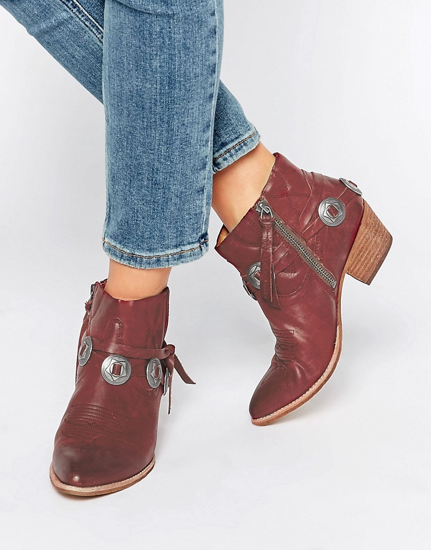 Skye Red Leather Western Heeled Ankle Boots Red Leather - predominant colour: burgundy; occasions: casual, creative work; material: leather; heel height: mid; heel: block; toe: pointed toe; boot length: ankle boot; style: cowboy; finish: plain; pattern: plain; embellishment: chain/metal; season: s/s 2016