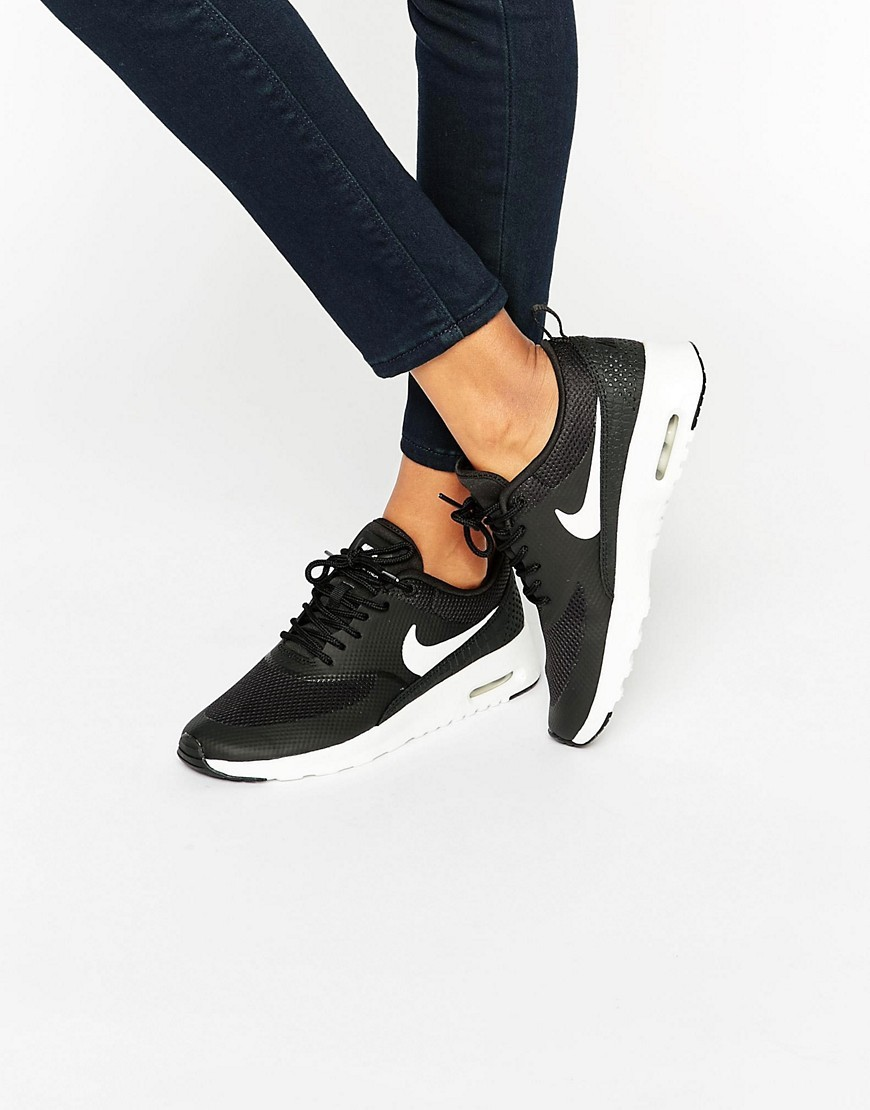 Air Max Thea Trainers In Black And White Black/Summit White - predominant colour: black; secondary colour: black; occasions: casual; material: fabric; heel height: flat; toe: round toe; style: trainers; finish: plain; pattern: plain; season: s/s 2016; wardrobe: basic