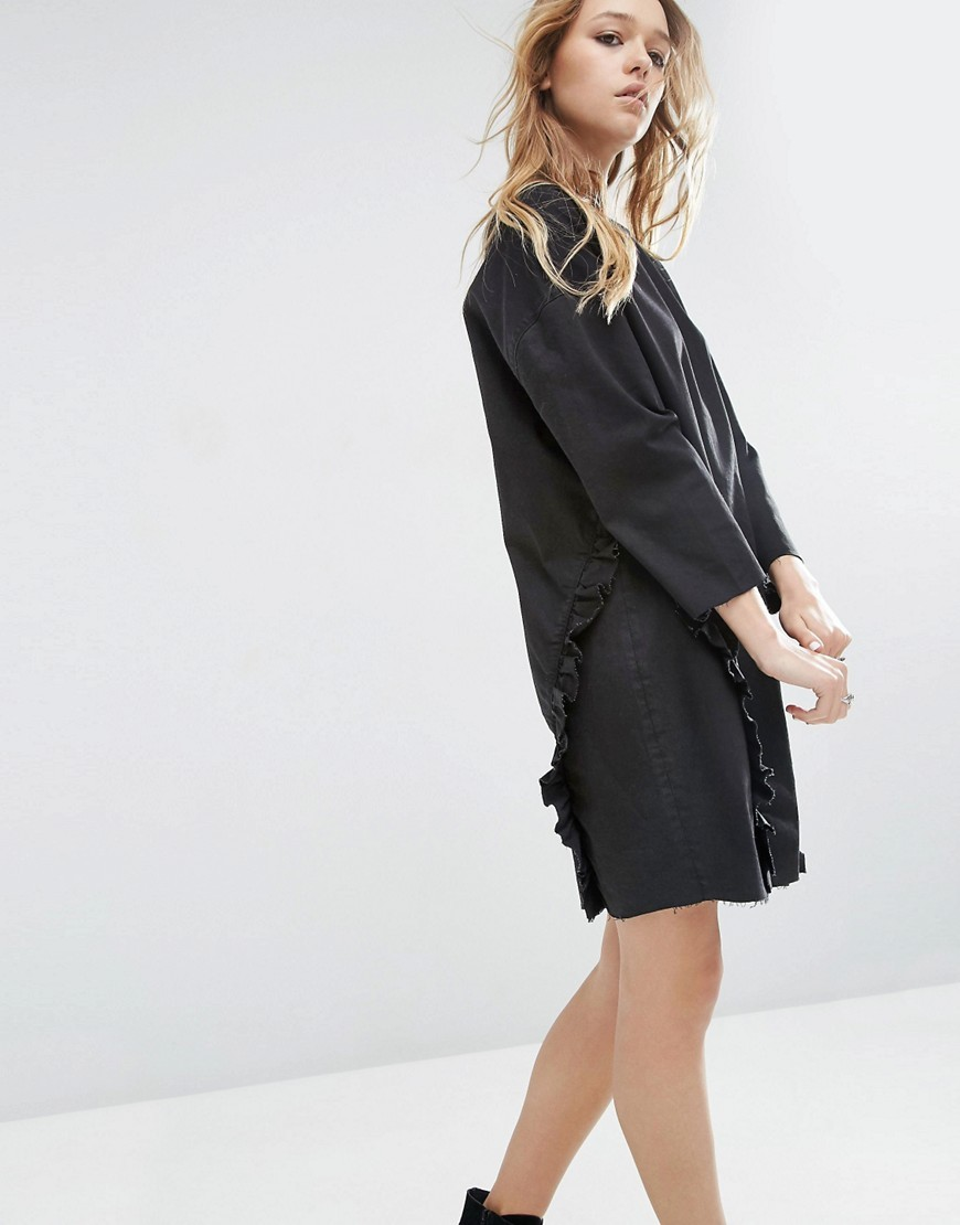 Denim Ovoid Shift Dress With Ruffle In Washed Black Black - style: shift; pattern: plain; predominant colour: black; occasions: evening; length: just above the knee; fit: body skimming; fibres: cotton - stretch; neckline: crew; hip detail: adds bulk at the hips; sleeve length: 3/4 length; sleeve style: standard; texture group: denim; pattern type: fabric; season: s/s 2016; wardrobe: event