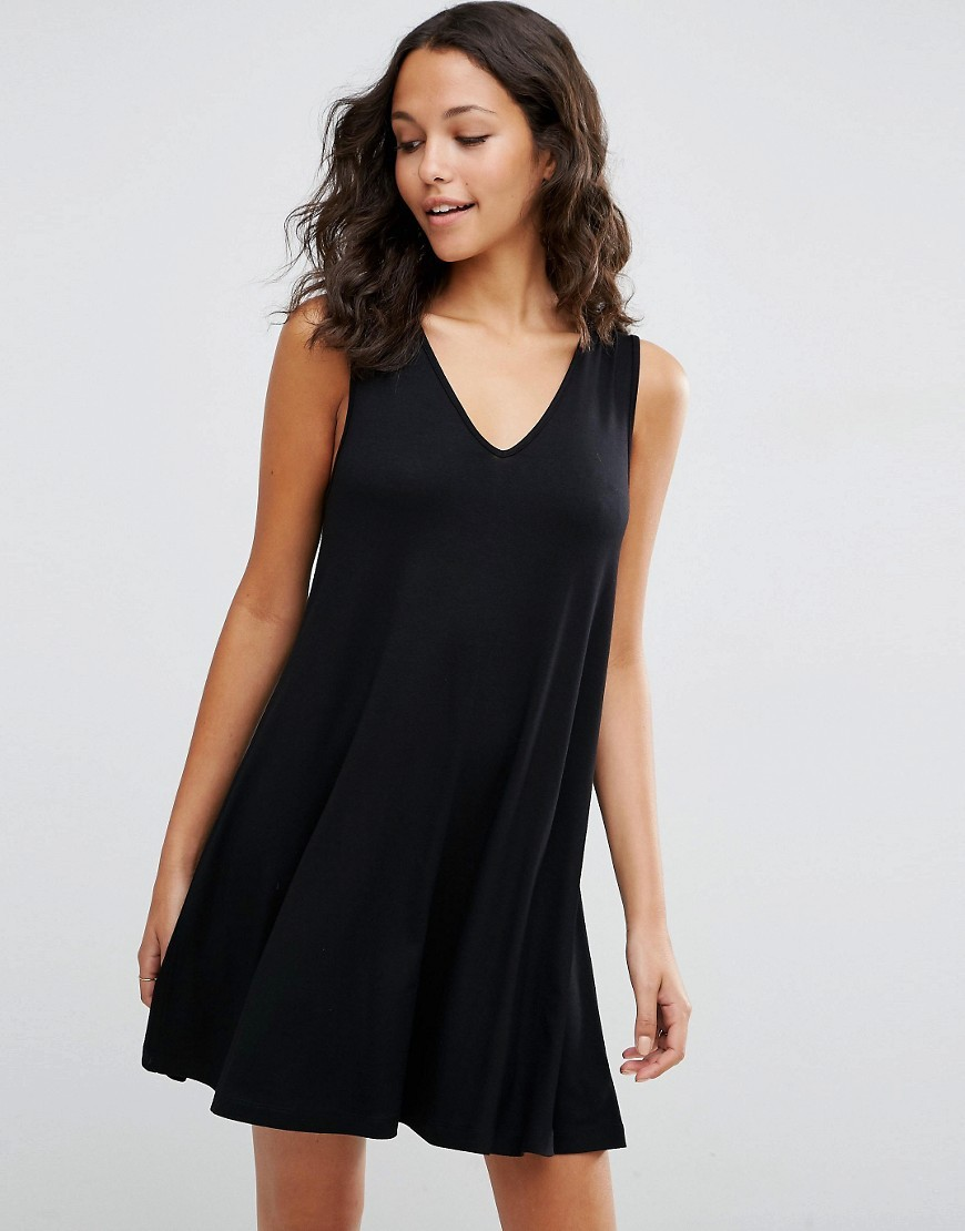 Sleeveless V Neck Swing Dress Black - style: trapeze; neckline: v-neck; fit: loose; pattern: plain; sleeve style: sleeveless; predominant colour: black; occasions: evening; length: just above the knee; fibres: viscose/rayon - stretch; sleeve length: sleeveless; pattern type: fabric; texture group: jersey - stretchy/drapey; season: s/s 2016