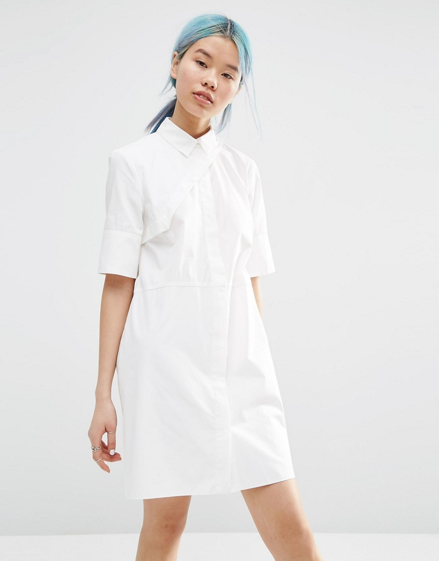 Shirt Dress With Asymmetric Front Detail White - style: shirt; neckline: shirt collar/peter pan/zip with opening; fit: tailored/fitted; pattern: plain; predominant colour: white; occasions: casual; length: just above the knee; fibres: cotton - 100%; sleeve length: half sleeve; sleeve style: standard; texture group: jersey - clingy; pattern type: fabric; season: s/s 2016; wardrobe: basic