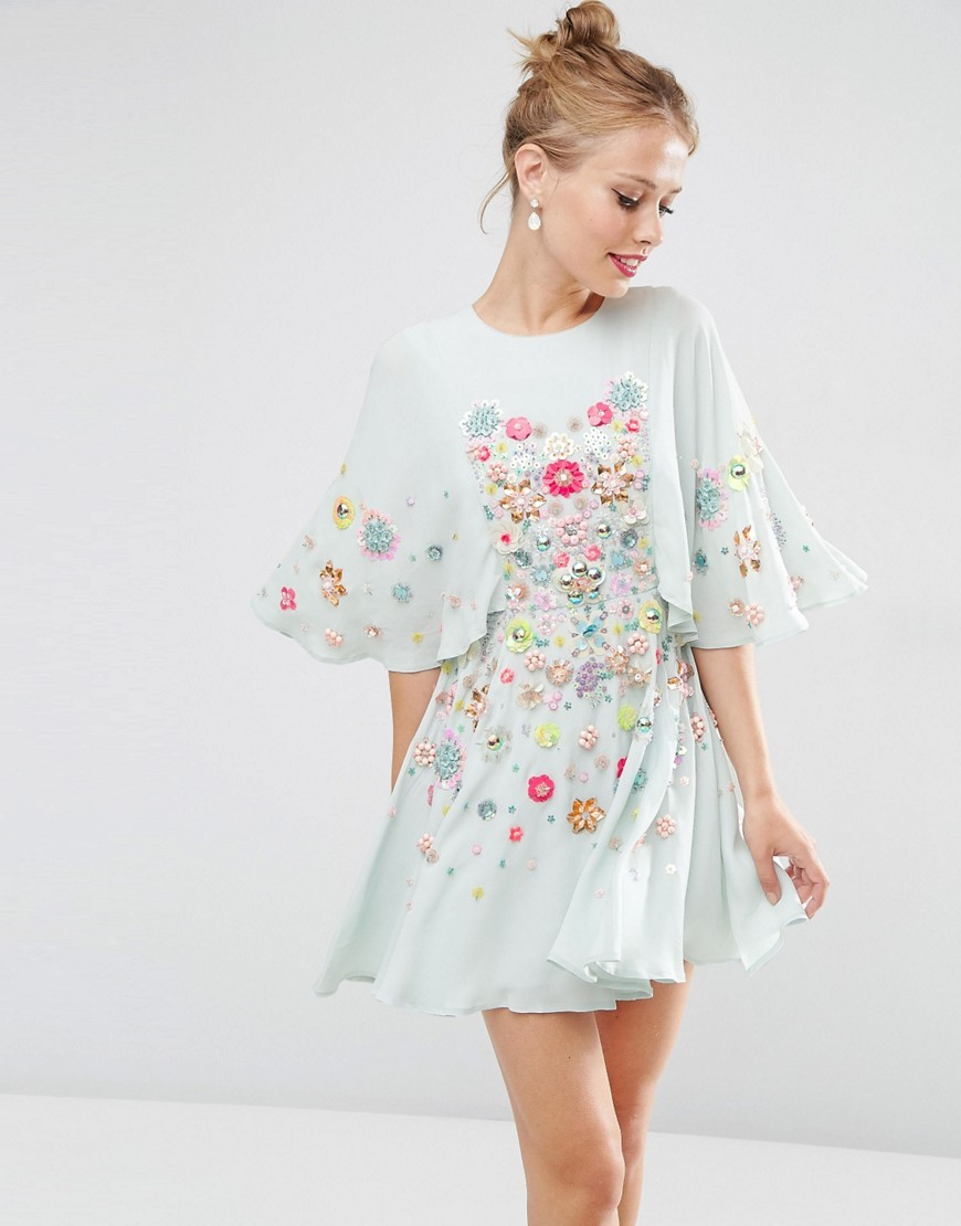 Salon 3 D Floral Embellished Cape Mini Skater Dress Blue - length: mid thigh; secondary colour: pink; predominant colour: pale blue; occasions: evening; fit: fitted at waist & bust; style: fit & flare; fibres: viscose/rayon - 100%; neckline: crew; sleeve length: 3/4 length; sleeve style: standard; texture group: sheer fabrics/chiffon/organza etc.; pattern type: fabric; pattern size: big & busy; pattern: florals; multicoloured: multicoloured; season: s/s 2016; wardrobe: event