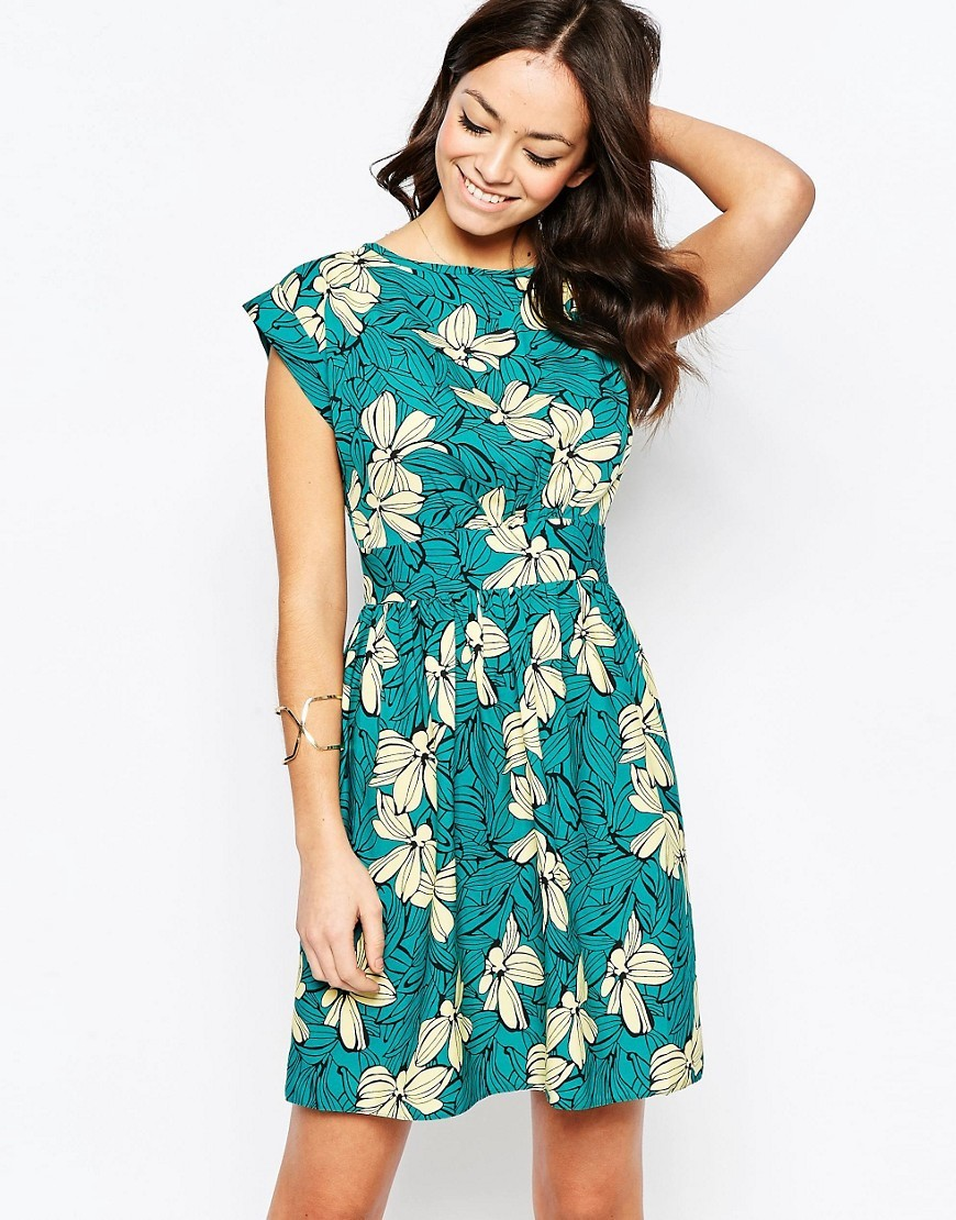 Closet Blu Tie Back Dress In Bright Floral Green - sleeve style: capped; secondary colour: ivory/cream; predominant colour: teal; occasions: casual; length: just above the knee; fit: fitted at waist & bust; style: fit & flare; fibres: polyester/polyamide - 100%; neckline: crew; sleeve length: short sleeve; pattern type: fabric; pattern size: big & busy; pattern: florals; texture group: jersey - stretchy/drapey; multicoloured: multicoloured; season: s/s 2016; wardrobe: highlight