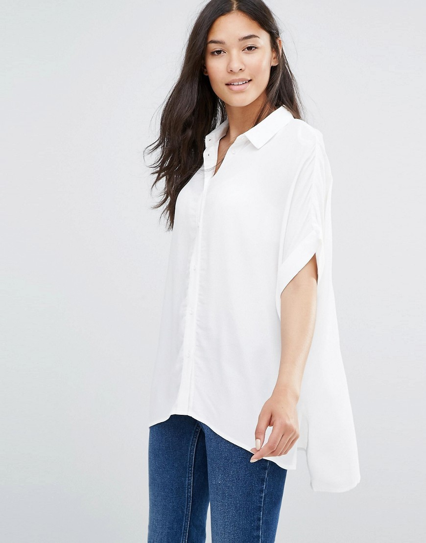 Boxy Shirt In Textured Fabric Lily White - neckline: shirt collar/peter pan/zip with opening; pattern: plain; length: below the bottom; predominant colour: white; occasions: casual, creative work; style: top; fibres: viscose/rayon - 100%; fit: loose; back detail: longer hem at back than at front; sleeve length: short sleeve; sleeve style: standard; pattern type: fabric; texture group: other - light to midweight; season: s/s 2016; wardrobe: basic