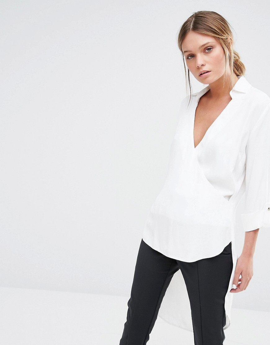 Closet Cross Over V Neck High Low Blouse White - neckline: v-neck; pattern: plain; style: wrap/faux wrap; predominant colour: white; occasions: work; length: standard; fibres: viscose/rayon - 100%; fit: body skimming; sleeve length: 3/4 length; sleeve style: standard; pattern type: fabric; texture group: other - light to midweight; season: s/s 2016; wardrobe: basic