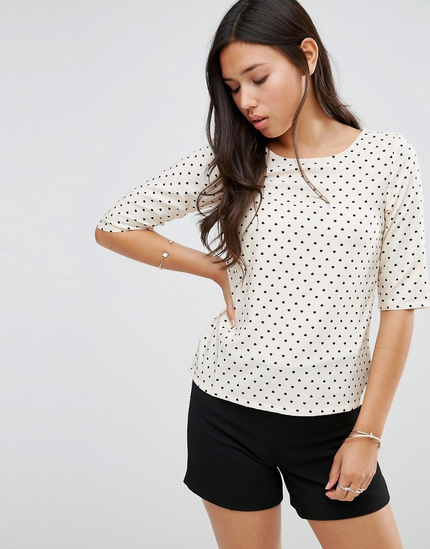 Polly Top Cream/Black - neckline: round neck; predominant colour: ivory/cream; secondary colour: black; occasions: casual, creative work; length: standard; style: top; fibres: polyester/polyamide - 100%; fit: body skimming; sleeve length: half sleeve; sleeve style: standard; pattern type: fabric; pattern size: standard; pattern: patterned/print; texture group: other - light to midweight; season: s/s 2016; wardrobe: highlight